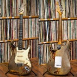 Rory's 1961 Fender Stratocaster front and back, standing in front of Rory's vinyl collection. Photographed by Eleanor Jane for G...